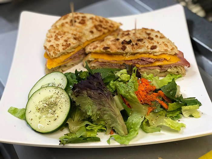 Ham sandwich with mixed green salad