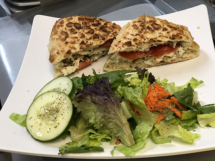 Sandwich with mixed green salad