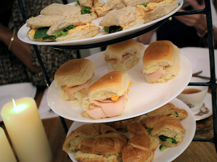 Small sandwiches on a tiered tray
